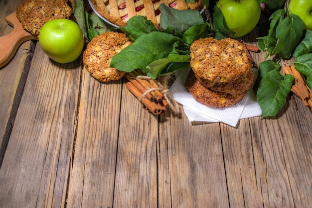 Fall traditional baking, homemade apple cake and apple pie oatmeal cinnamon cookies, halloween thanksgiving, autumn baking food, cozy baking wooden background copy space