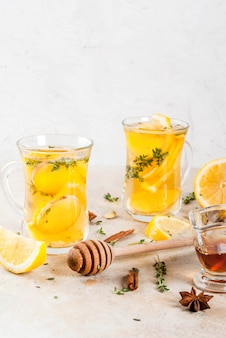 Fall and winter traditional drinks. warming hot tea with lemon, ginger, spices