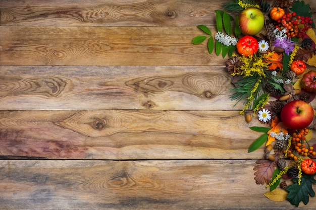 Fall  with pumpkin and green leaves on wooden table