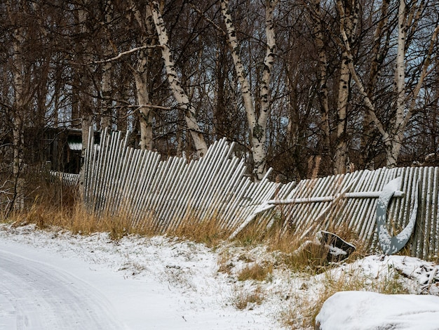 A fallen old wooden fence. old fishing fence.