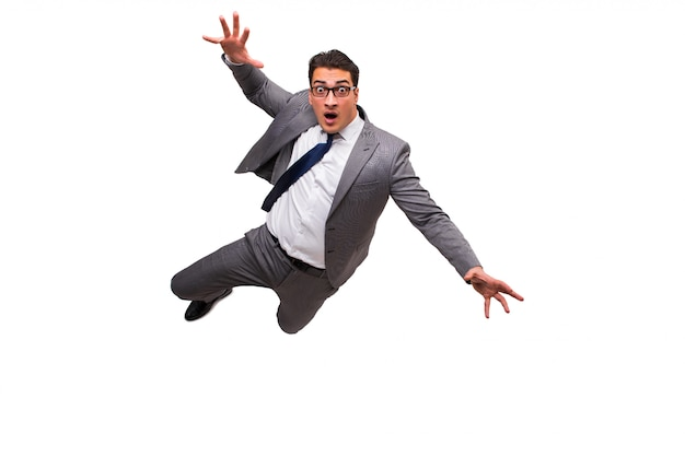 Falling businessman isolated