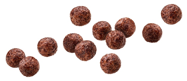 Falling chocolate corn balls isolated on white background with clipping path