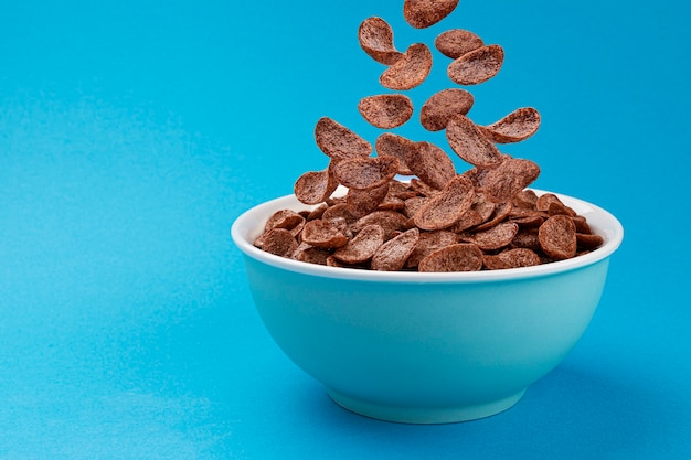 Falling chocolate corn flakes, healthy cereal breakfast
