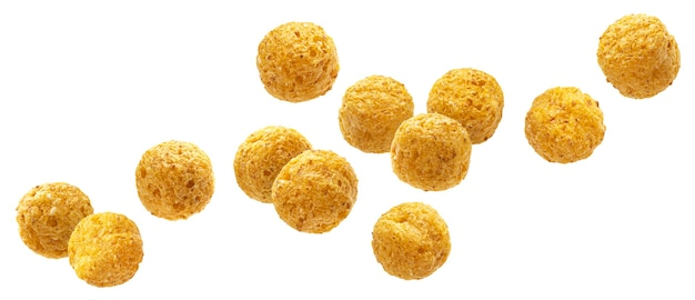 Falling corn balls isolated on white background with clipping path