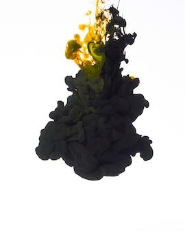 Falling dark droplet of ink