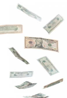 Falling dollars isolated on white