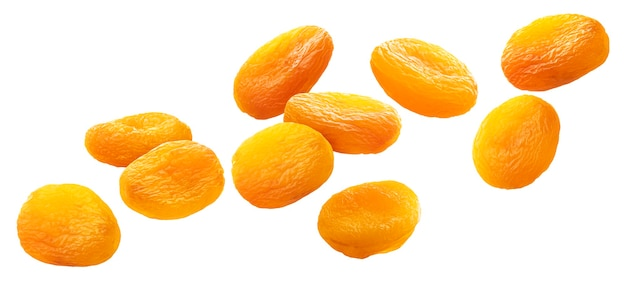 Falling dried apricots isolated on white