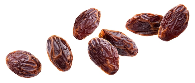 Falling dried big jumbo dates isolated on white background with clipping path