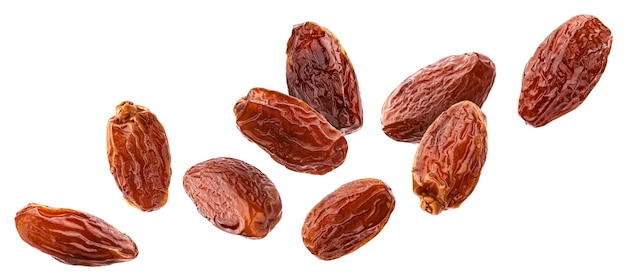 Falling dried dates isolated on white background with clipping path