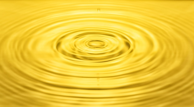 Falling drops on the water surface, splash, ripples on the water, yellow color