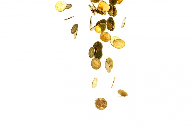 Falling gold coins money isolated on the white background