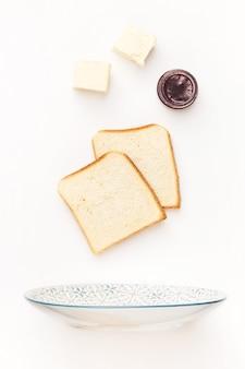 The falling ingredients of fried toastes. healthy breakfast ingredients.