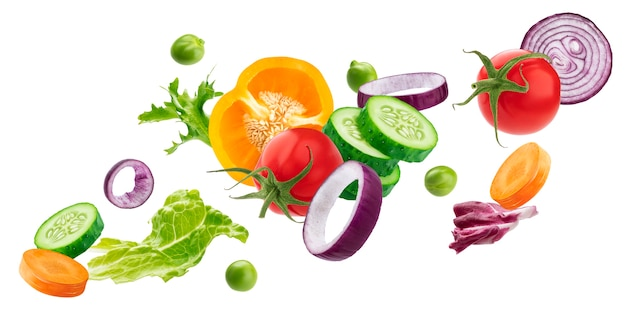 Falling mix of different vegetables, fresh salad ingredients isolated on white surface