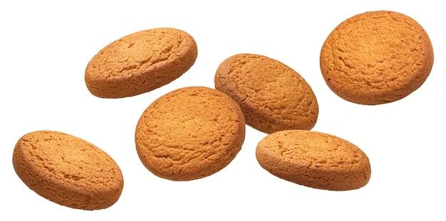 Падающее овсяное печенье, изолированные на белом фоне