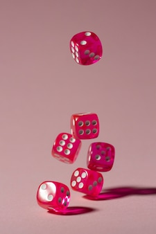 Falling pink dices on pink background