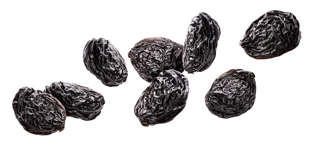 Falling prunes isolated on white