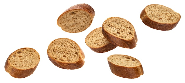 Falling slices of rye bread isolated on white background