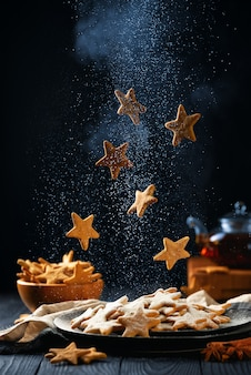 Falling star-shaped cookies with powdered sugar
