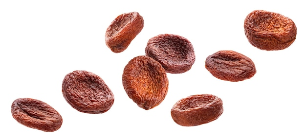 Falling sun dried apricots isolated on white background with clipping path
