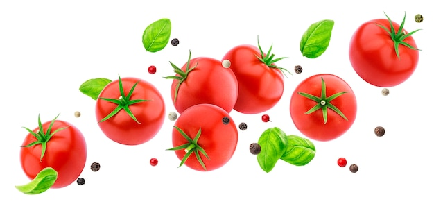 Falling tomatoes salad isolated on white with clipping path