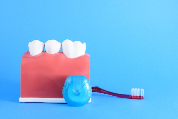 False mouth dentist in blue
