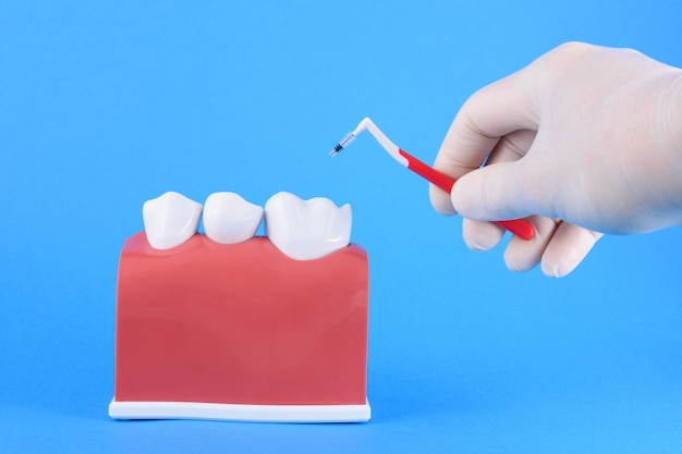 False mouth dentist in blue