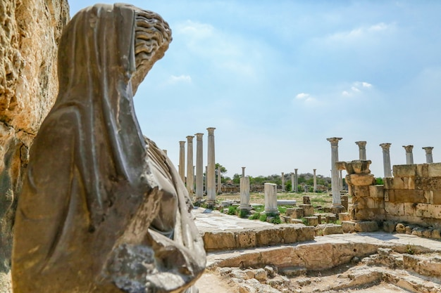 Famagusta, turkish republic of northern cyprus. columns and sculptures at ancient city salamis ruins.