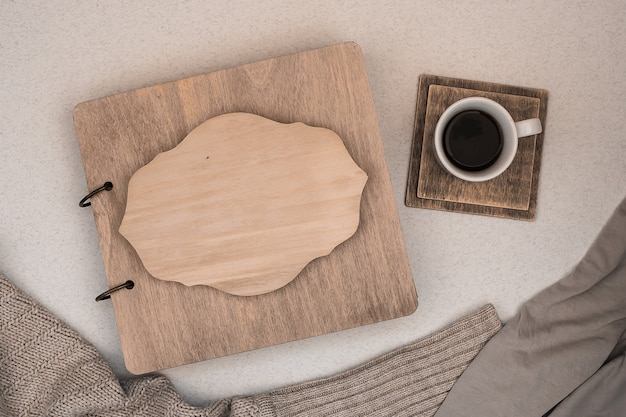 Family album with wooden cover. copy space. autumn concept. coffee.
