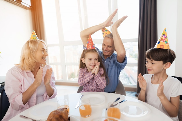 Family are congratulate the little girl on her birthday