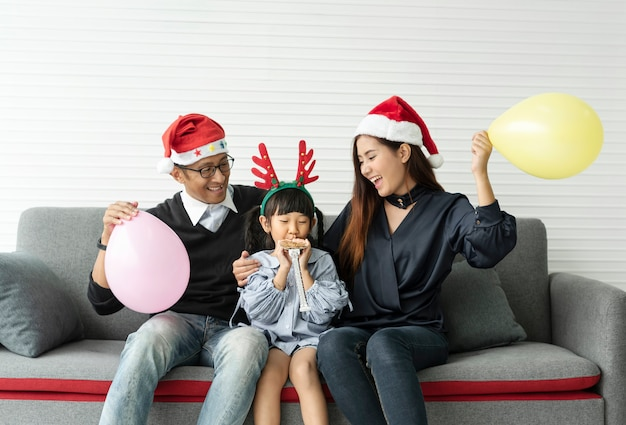 Family asian mother and father with daughter celebration happy christmas together