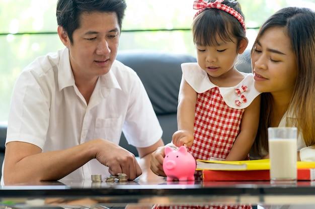 Family asian saving money in piggy bank . save money