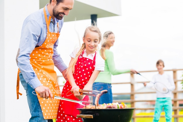 Family barbecue together in garden home