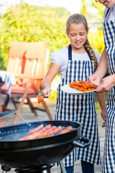 Family barbecue together on terrace