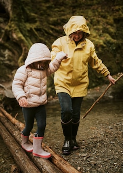 Family camping trip mother and daughter walking in the forest