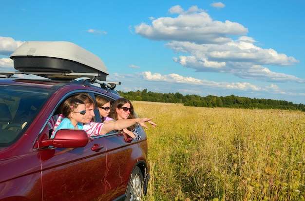 Family car travel on vacation, happy parents and kids have fun in holiday trip, insurance concept