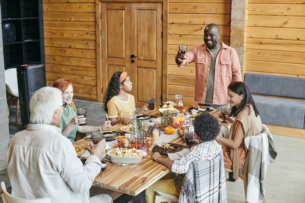 Family celebrating at dining the table