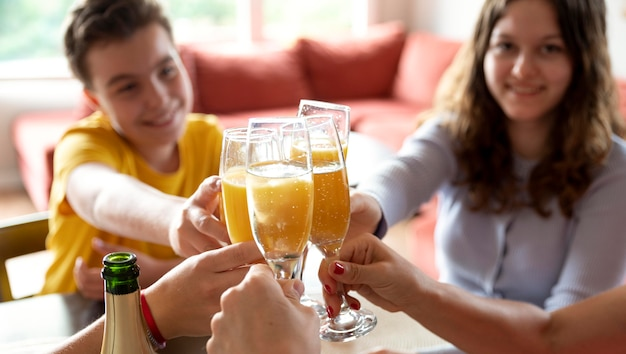Family cheering with champagne glasses at home