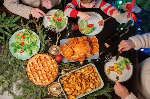 Family at christmas dinner, top view