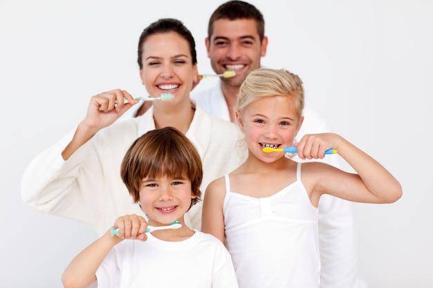 Family cleaning their teeth in bathroom