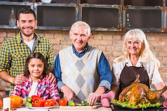 Family cooking turkey with vegetables