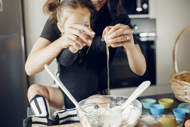 Family cooks the dough for cookies