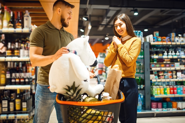 Family couple in grocery store, consumerism