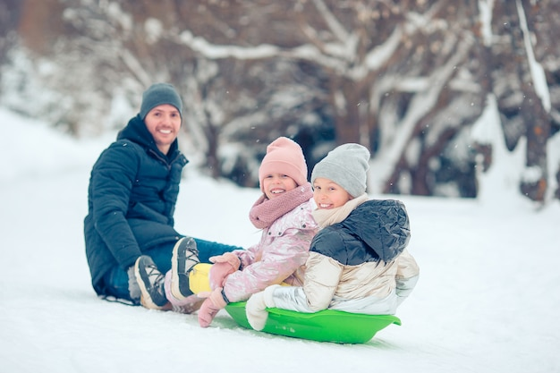 Family of dad and kids vacation on winter outdoors