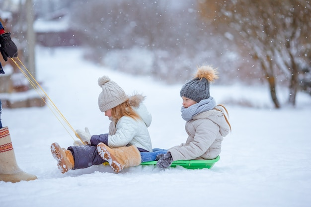 Family of dad and kids vacation on winter