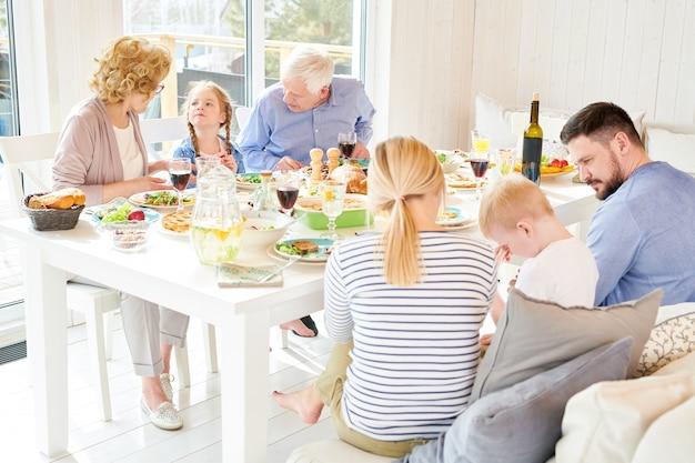 Family dinner in sunlight