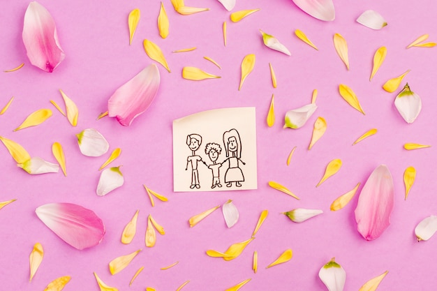 Family drawing on paper among fresh petals