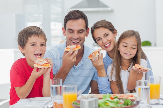 Family eating pizza slices