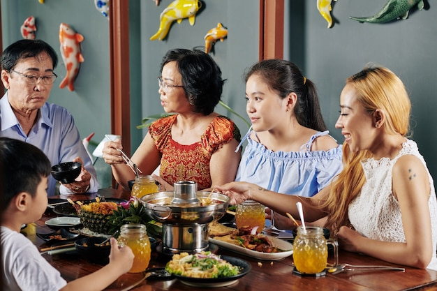 Family eating traditional dishes