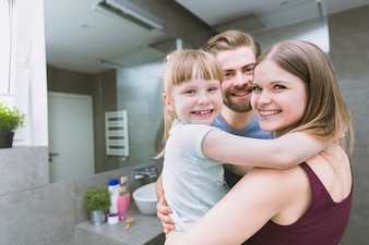 Family embracing in bathroom