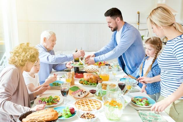 Family enjoying festive dinner in sunlight